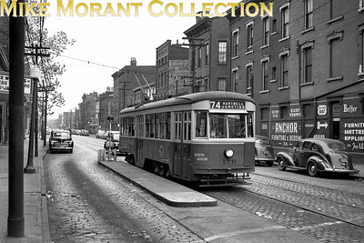 Cincinnati Street RailwayCar 176, a 1928-built Peter Witt, on McMicken Street at Vine Street, on a fan trip using a Route 74-Hartwell Junction destination sign.  Photo taken in 1949.CAPTION TEXT KINDLY SUPPLIED BY CLIFF SCHOLES.