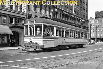 """Cleveland Transit SystemSingle ended city car no. 260  -  off side.Photographed at West Public Square and Superior Avenue. The building in the background with the sign """"American Bus Co."""" on it was originally the station for the Lake Shore Electric interurban system and other interurban operations out of Cleveland.CAPTION TEXT KINDLY SUPPLIED BY CLIFF SCHOLES."""