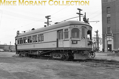 Fort Dodge, Des Moines & SouthernCar 74, a 1907 Niles Car Co. Built combination passenger/baggage car, showing right side and baggage door end of the car in 1948.CAPTION TEXT KINDLY SUPPLIED BY CLIFF SCHOLES.
