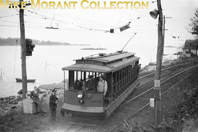 Connecticut CompanyCar 1412, a 1911 Osgood-Bradley Co. built 15-bench open car on a fan trip at almost certainly Short Beach CT, a few hundred yards from the present end-of-track of the Shore Line Trolley Museum, Branford CT, whose present right-of-way was originally part of this line to Short Beach and beyond.  Photo taken in 1947.CAPTION TEXT KINDLY SUPPLIED BY CLIFF SCHOLES.