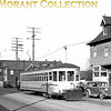 "<b>Cleveland Transit System</b><br>An unknown numbered car in the 450-499 series, a 1920 G. C. Kuhlman Co. built Peter Witt, on Madison Avenue in Lakewood, a western suburb of Cleveland.  Photo taken March, 1946.<br><font size=""1"">CAPTION TEXT KINDLY SUPPLIED BY CLIFF SCHOLES.</font>"
