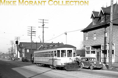 Cleveland Transit SystemAn unknown numbered car in the 450-499 series, a 1920 G. C. Kuhlman Co. built Peter Witt, on Madison Avenue in Lakewood, a western suburb of Cleveland.  Photo taken March, 1946.CAPTION TEXT KINDLY SUPPLIED BY CLIFF SCHOLES.