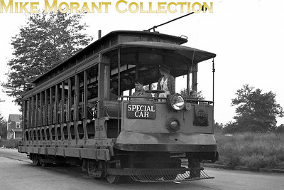 Connecticut CompanyCar 615, a 1901 J. G. Brill Co. built 15-bench open car on a fan trip somewhere in the New Haven area.  This car, now numbered 303, is at the Seashore Trolley Museum, Kennebunkport, Maine.  Photo taken in 1947.CAPTION TEXT KINDLY SUPPLIED BY CLIFF SCHOLES.