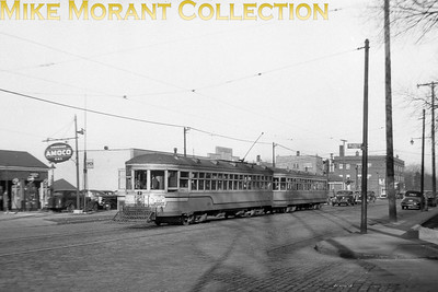 Cleveland Transit SystemCar 480, a Peter Witt, and trailer 2489, both 1920 G. C. Kuhlman Co. built cars on Detroit Avenue at Bunts Road in Lakewood, a suburb of Cleveland.  Photo taken March, 1946.CAPTION TEXT KINDLY SUPPLIED BY CLIFF SCHOLES.