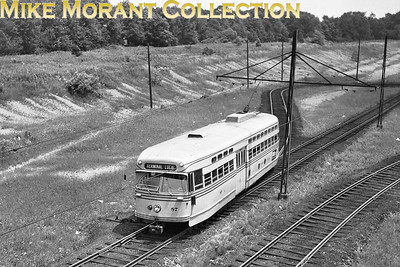 Shaker Heights Rapid TransitCar 87, a 1947 Pullman Co. built PCC at the Shaker Boulevard line's Green Road loop, the end of that line.  The car has traversed the loop and is heading toward Terminal Tower in downtown Cleveland.  Photo taken in 1950.CAPTION TEXT KINDLY SUPPLIED BY CLIFF SCHOLES.