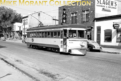 Cedar Rapids & Iowa CityLightweight interurban car no. 118, one of the  ex-Cincinnati & Lake Erie highspeed cars that were nicknamed Red Devils and built by the Cincinnati Car Co. in 1930, with the original number retained  and photographed in front of the CRANDIC station on College Street in Iowa City.CAPTION TEXT KINDLY SUPPLIED BY CLIFF SCHOLES.