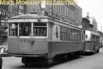 Knoxville Street RailwayCar 372, a 1928 Cincinnati Car Co. built curved-side lightweight, the last car in the final order for this style car by KSRy.  The cars were scrapped after abandonment of the system, August 1, 1947.  Photo taken in 1946 in downtown Knoxville.CAPTION TEXT KINDLY SUPPLIED BY CLIFF SCHOLES.