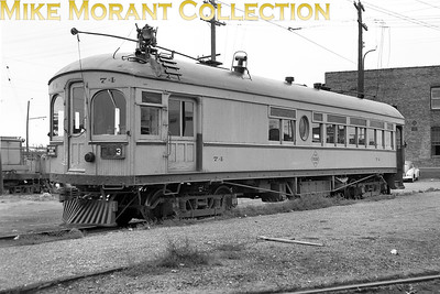 Fort Dodge, Des Moines & SouthernCar 74, a 1907 Niles Car Co. Built combination passenger/baggage car at the Des Moines, Iowa station, showing the left side and baggage door end of the car, in 1948.CAPTION TEXT KINDLY SUPPLIED BY CLIFF SCHOLES.