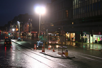 Ah, I see now.  The lights are to illuminate the tram stop - or dazzle drivers.  You choose.