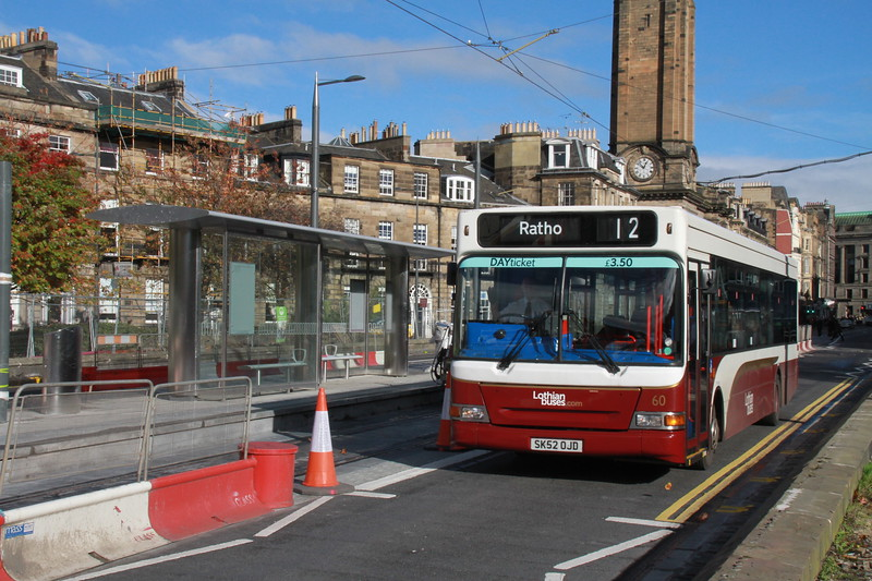 60's driver gives a cheery wave as he passes the West End - Princes Street tram stop