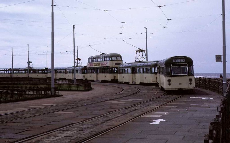 Twin-set trams and trailers and a balloon car, Blackpool, Sun 12 August 1973.  On the turning loop at Pleasure Beach.  Trailer 681 is nearest.  Photo by Les Tindall.