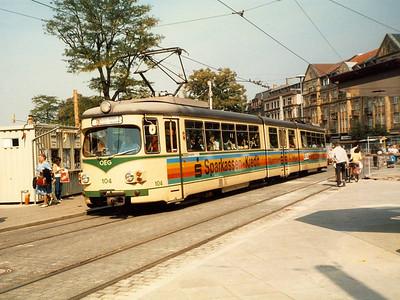 The Oberrheinische Eisenbahn Gesellschaft (OEG) runs trams between Mannheim, Weinheim and Heidelberg. Duewag 8-axle car 104 is seen in Bismarckplatz.