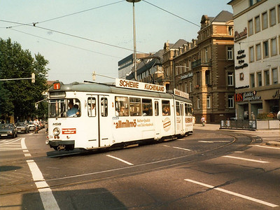 Another tram, another advertising livery: 1973 built 234 seen turning from Rohrbackerstrasse onto Kurfursten-Anlage