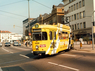 HSB 244 of 1973 in an advertising livery turning from Kurfursten-Anlage into Rohrbackerstrasse.