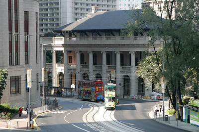 No 129 passes the Legislative Council Building in Central district with a service to Causeway Bay on 20/11/2004, closely followed by No 23 working to Happy Valley.