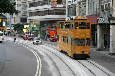 No 135 navigates Johnston Street, Wan Chai with a service to Whitty Street Depot on 21/11/2004.