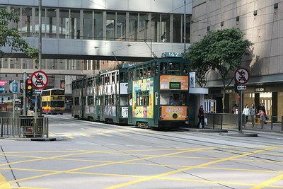 A tram jam. No 162 leads no fewer than four units in Central district on 20/11/2004 with a service to Kennedy Town. No 50 follows with a Whitty Street service and behind that is No 24 also working to Kennedy Town, the last car remains unidentified.