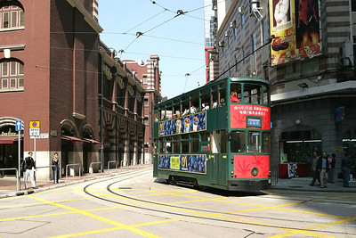 No 151 departs from Western Market and turns onto Morrison Street, Sheung Wan on 22/11/2004 with a service for Shaukeiwan.
