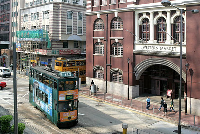 No 143 rounds the corner at Western Market onto Connaught Road West, Sheung Wan with a service to Kennedy Town on 22/11/2004.
