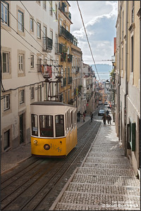 The Elevador da Bica (Bica Funicular) runs along the steep Rue da Bica de Duarte Belo, linking Rua São Pedro de Alcântara at the bottom of the hill with Largo Calhariz at the top. Here one of the two cars that opearte the route is pictured between runs at the top of the incline on 22/11/2016.