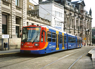 """029: Around this time it was announced that the trams would be """"refreshed"""" (what is wrong with refurbished?). First one done was 115, seen here in April 2006 at Fitzalan Square in the predominantly red and blue livery. Despite the brightness of the colours, it all seems a bit too dark for my liking."""