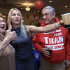 Jane Cook of Fitchburg, Fitchburg Councilor Sam Squailia and Frank Ardinger of Leominster watch the results on a big screen at Senator Dean Tran's campaign party at the Leominster Elks. SENTINEL & ENTERPRISE/JOHN LOVE