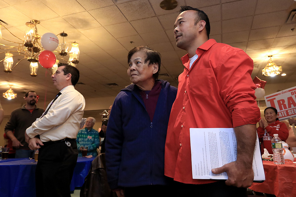 . Senator Dean Tran stands with his mom Dong Tran as he is introduced by Leominster Mayor Dean Mazzarella at his campaign party at the Leominster Elks. SENTINEL & ENTERPRISE/JOHN LOVE