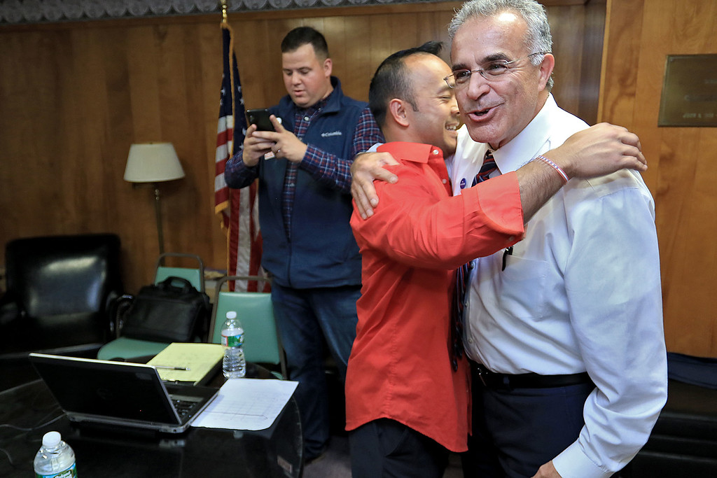 . Senator Dean Tran is congratulated by Leominster Mayor Dean Mazzarella as he waits in a back room during his campaign party at the Leominster Elks. SENTINEL & ENTERPRISE/JOHN LOVE
