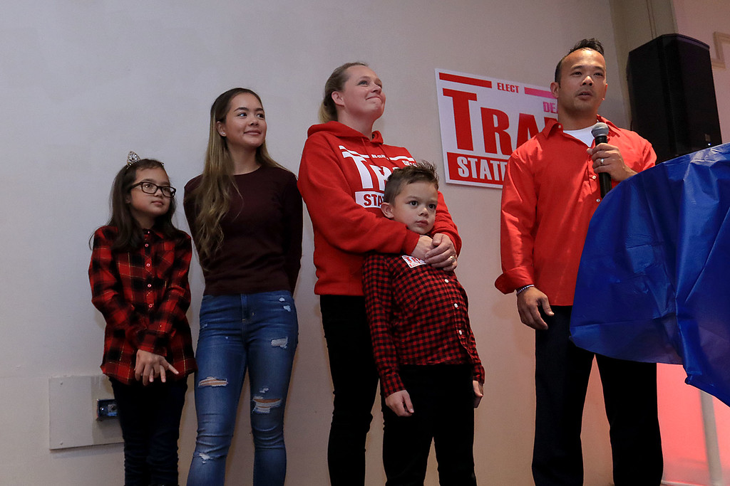 . Senator Dean Tran stands with his family as he addresses the crowd at his campaign party at the Leominster Elks, November 6, 2018. From left is Madilyn, 8, Olivia, 15, Deano, 5, and his wife Kerry. SENTINEL & ENTERPRISE/JOHN LOVE
