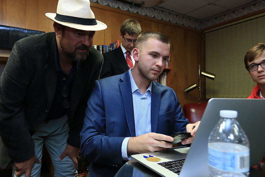 . State Rep candidate Elmer Eubanks and Senator Dean Trans Campaign manager Austin Cyganiewicz look at the results on a laptop at Tran\'s campaign party at the Leomisnter Elks, November 6, 2018. SENTINEL & ENTERPRISE/JOHN LOVE
