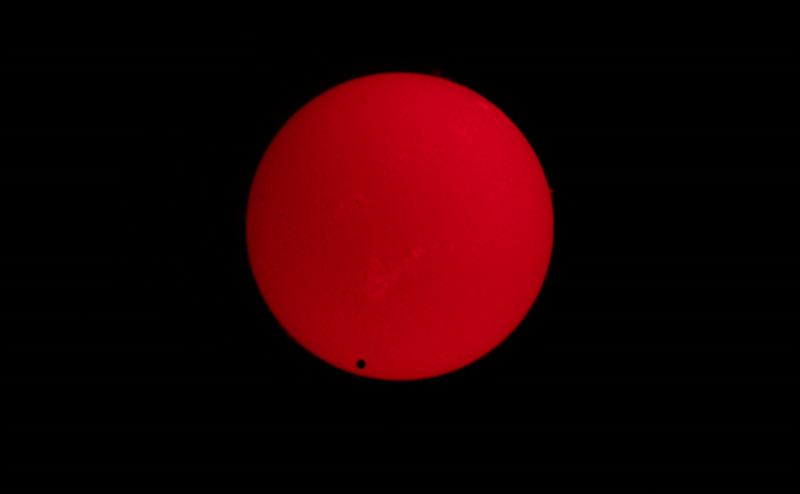 The black circle you see on the Sun is the planet Venus. You can also see some protuberances on the edge of the Sun.