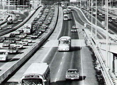 1970-1996 – in the Northern Virginia suburbs of Washington, DC, the Shirley Busway was deemed a great success upon its opening in 1970. The pre-existing Route 18 was expanded from three trips per day (without subsidy) to approximately thirty trips with subsidy – yielding a substantial increase in ridership. However, with long gaps between buses, political pressure grew to convert the busway into an HOV lane, opening it up for use by automobiles. Ridership peaked in 1980-81 during the second energy crisis. Subsequently it declined 67% as costs increased sharply. At the same time, transit ridership in the National Capital area ballooned from 135 million per year to 270 million, mainly because of the introduction of the MetroRail system. (LIGHT RAIL NOW)