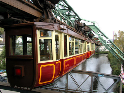 Here is the Train of the Future circa 1900 in Wuppertal, Germany. This amazing antique is maintained and still operates.