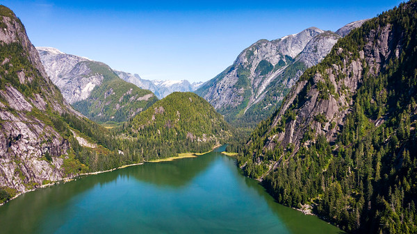 Instead of Vietnam or Myanmar, enter the realm of the Coast Mountains and the world of the Kitlope Valley. Ancient home of the Hennaksiala, this is also the largest intact temperate rainforest on the planet.