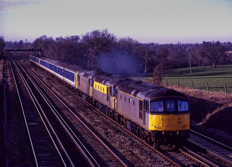 On 3rd January 1991, 33116 failed at Hook with the 09:00 Yeovil Junction - Waterloo. <br /> 33002 and 33118 came to the rescue, and the train is shown back on the move <br /> at Totters Lane, Potbridge.