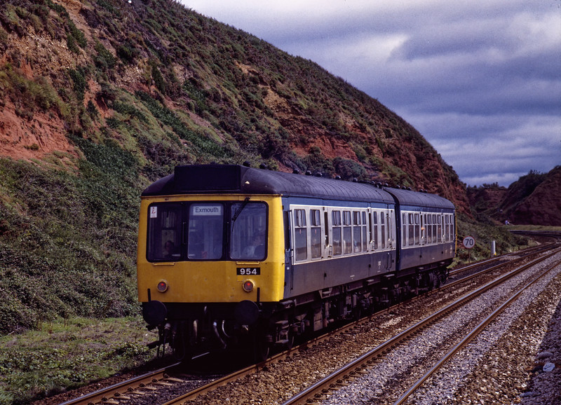 DMMU 954 approaches Langstone Rock with the 11:10 Paignton - Exmouth, <br /> on 7th July 1990.