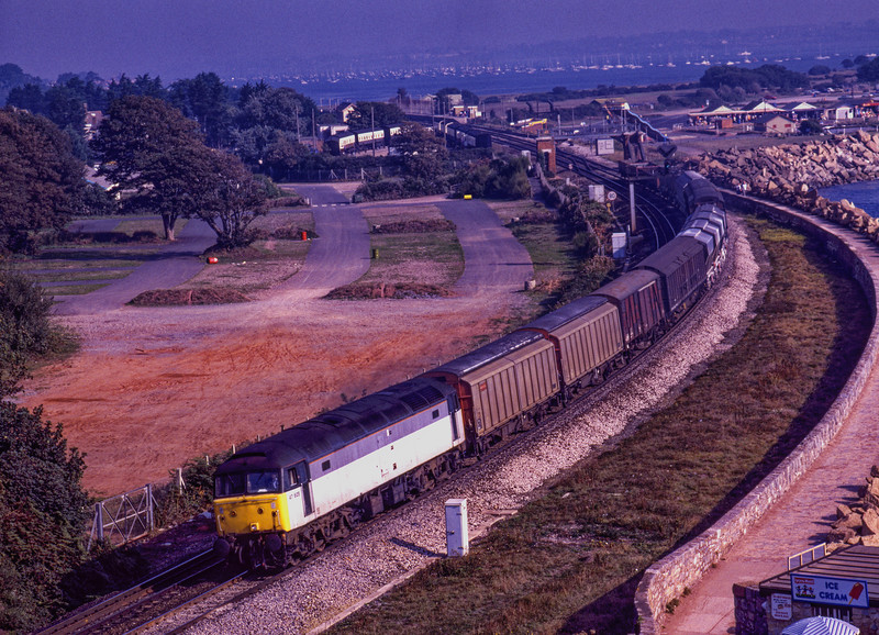 47605 rounds the curve at Dawlish Warren, with 6V92 the 15:00 Coatbridge - Tavistock Junction, on 11th September 1990.