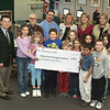Students at Fox Elementary School donate 00 dollars to the Transplant Institute on behalf of teacher who received a liver transplant in March 2004