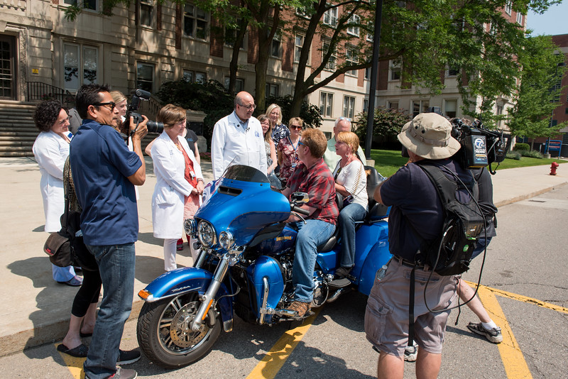 """""""Welcome Home"""" press event for transplant patient Ronald Wilmoth and his wife Becky. His injuries resulted in a double lung transplant  and his wife. His transplant was after he was hit by a tire that came over the median and almost killed him riding his motorcycle on I-94 in 2016. Now he's returning from a cross-country trip on his 3-wheeled motorcycle, celebrated and welcomed by Transplant Institute staff"""