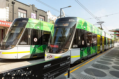 Two Modern Trams at St Kilda beach