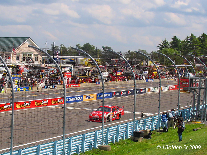 Tony Stewart wins the Heluva Good Sour Cream Dips at The Glen.<br /> History making 5th Win at WGI for Tony.<br /> Shot I snapped over my head on my way out of the grandstands!<br /> Even impressed myself!!