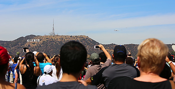 The Endeavour being transported to LAX by piggy-back on a NSA 747 did a fly-by over and around Griffith Park Observatory 9/21/12.  There were massive people there to see it and hikers that had climbed to tops of mountains for a better view.