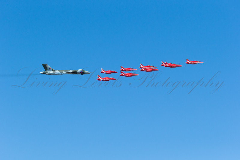 Avro 698 Vulcan B.2 XH558 takes part in its final RIAT fly past accompanied by the RAF Red Arrows with smoke on.