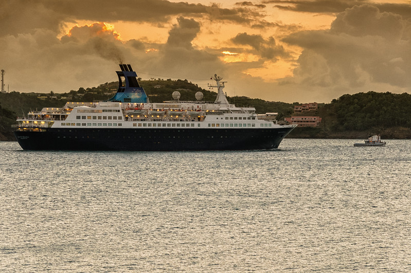 "Saga Cruise ship ""Quest for Adventure"" passing Fort James St. John's Harbour at sunset, Antigua"