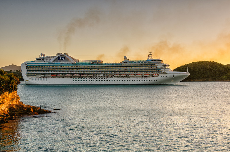 "Emerald Cruise Ship ""Emerald Princess"" passing Fort James St. John's Harbour at sunset, Antigua"