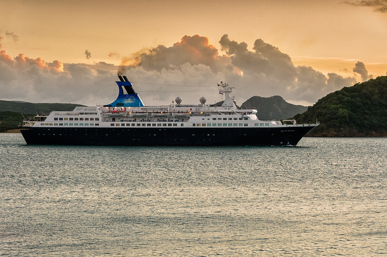 "Saga Cruise ship ""Quest for Adventure"" leaving St. John's Harbour at sunset, Antigua"