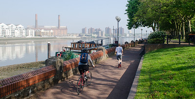 Cyclist and jogger on River Thames path during smog