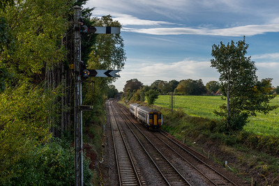156412 heads towards the soon-to-be remodelled Reedham Junction, working 2C23 Great Yarmouth to Norwich.