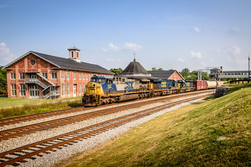 CSX AC44CW No 247 as lead on triple header mixed freight, Martinsburg, West Virginia