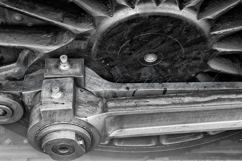 A close up of one of the main driving wheels and rods on GWR large prairie 4160 on a cold frosty morning at Bishops Lydeard.